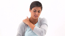 Brunette woman holding her painful shoulder Footage