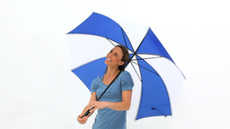 Woman turning her umbrella Stock Video Footage