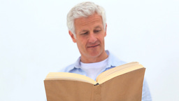 Retired man reading a book Stock Video Footage