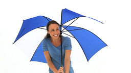 Happy woman with an umbrella Stock Video Footage
