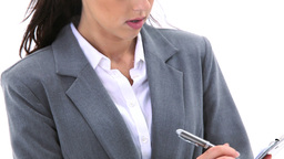 Businesswoman writing on a notepad Footage