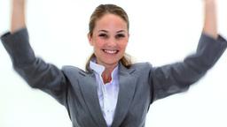 Blonde businesswoman raising her arms Footage