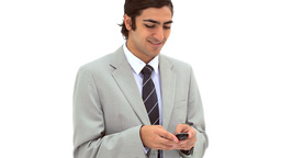 Smiling businessman texting on his mobile phone Stock Video Footage