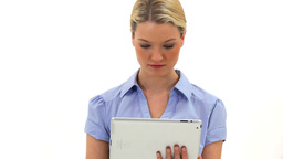 Cheerful blonde woman using a tablet computer Stock Video Footage