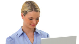 Smiling blonde woman holding a laptop Stock Video Footage