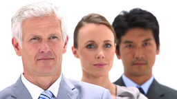 Three business people in a line Stock Video Footage