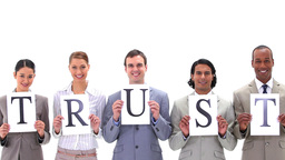 Business team holding boards with the word TRUST Footage