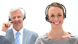 Business people speaking into a headset Stock Video Footage