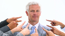 Man shaking his head while fingers are pointed at  Footage