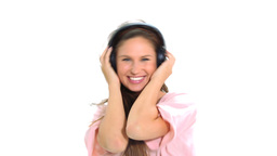 Woman with headphones is dancing and jumping Stock Video Footage