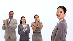 Young woman being congratulated by coworkers Stock Video Footage