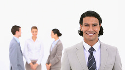 Smiling businessman with colleagues standing behin Footage