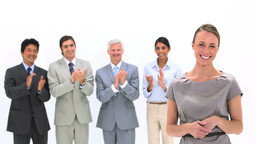 Business people applauding a woman Stock Video Footage