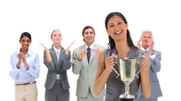 Woman holding a trophy with coworkers applauding Footage