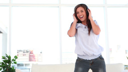 Smiling woman dancing while raising her arms Stock Video Footage