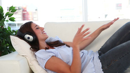 Young smiling woman listening to music Stock Video Footage