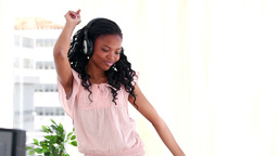 Young woman using headphones while dancing Stock Video Footage