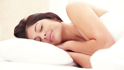 Peaceful young brunette sleeping Stock Video Footage