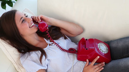 Brunette woman using her red phone Stock Video Footage