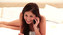 Smiling young brunette using her cellphone Stock Video Footage