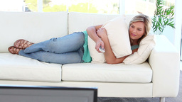 Peaceful woman watching the television Footage