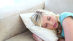 Young blonde woman sleeping Footage