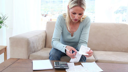 Blonde woman having financial problems Stock Video Footage