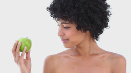 Woman holding a green apple Stock Video Footage