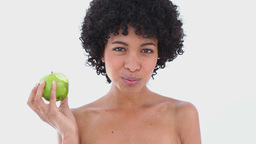 Woman eating a green apple Footage