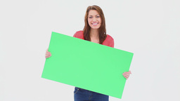 Brunette haired woman dancing with a blank poster Stock Video Footage