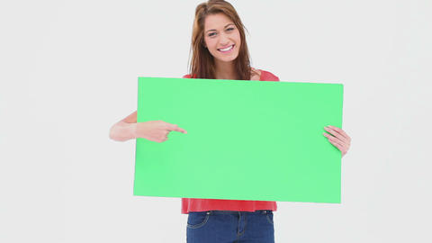 Woman holding and pointing a blank poster Footage