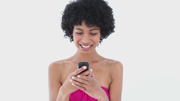 Smiling woman using her mobile phone Footage