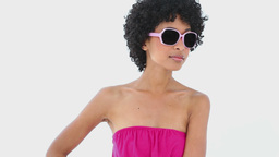 Woman in pink wearing sunglasses Footage