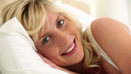 Young blonde haired woman resting Footage