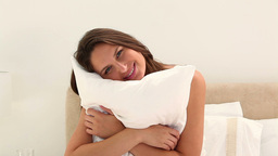 Woman embracing a pillow Live Action