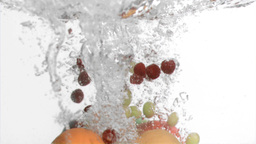 Fruits in super slow motion falling in the water Footage