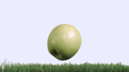 Apple in super slow motion falling on the grass Footage