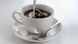 Milk dripping in super slow motion in a coffee cup Footage