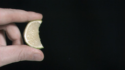 Lime in super slow motion being squeezed Stock Video Footage