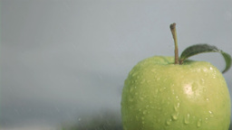Rain falling in super slow motion on an apple Stock Video Footage
