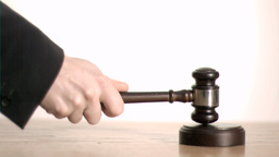 Judge In Super Slow Motion Holding A Gavel stock footage