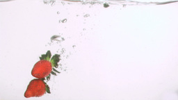 Strawberries falling in super slow motion in the w Footage