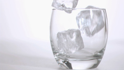 Ice cubes in super slow motion falling in a tumble Footage