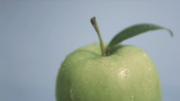 Green apple in super slow motion receiving water Footage