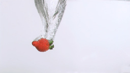 Delicious strawberry in super slow motion dropping Stock Video Footage