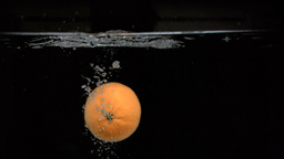Orange floating in super slow motion Stock Video Footage