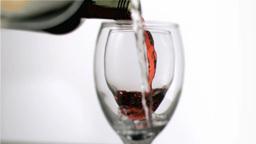 Bottles of wine in super slow motion filling glass Footage