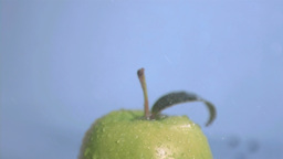 Rain in super slow motion falling on a green apple Footage