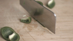 Green pepper in super slow motion being cut Stock Video Footage
