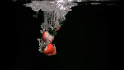 Strawberries dropping in super slow motion Footage